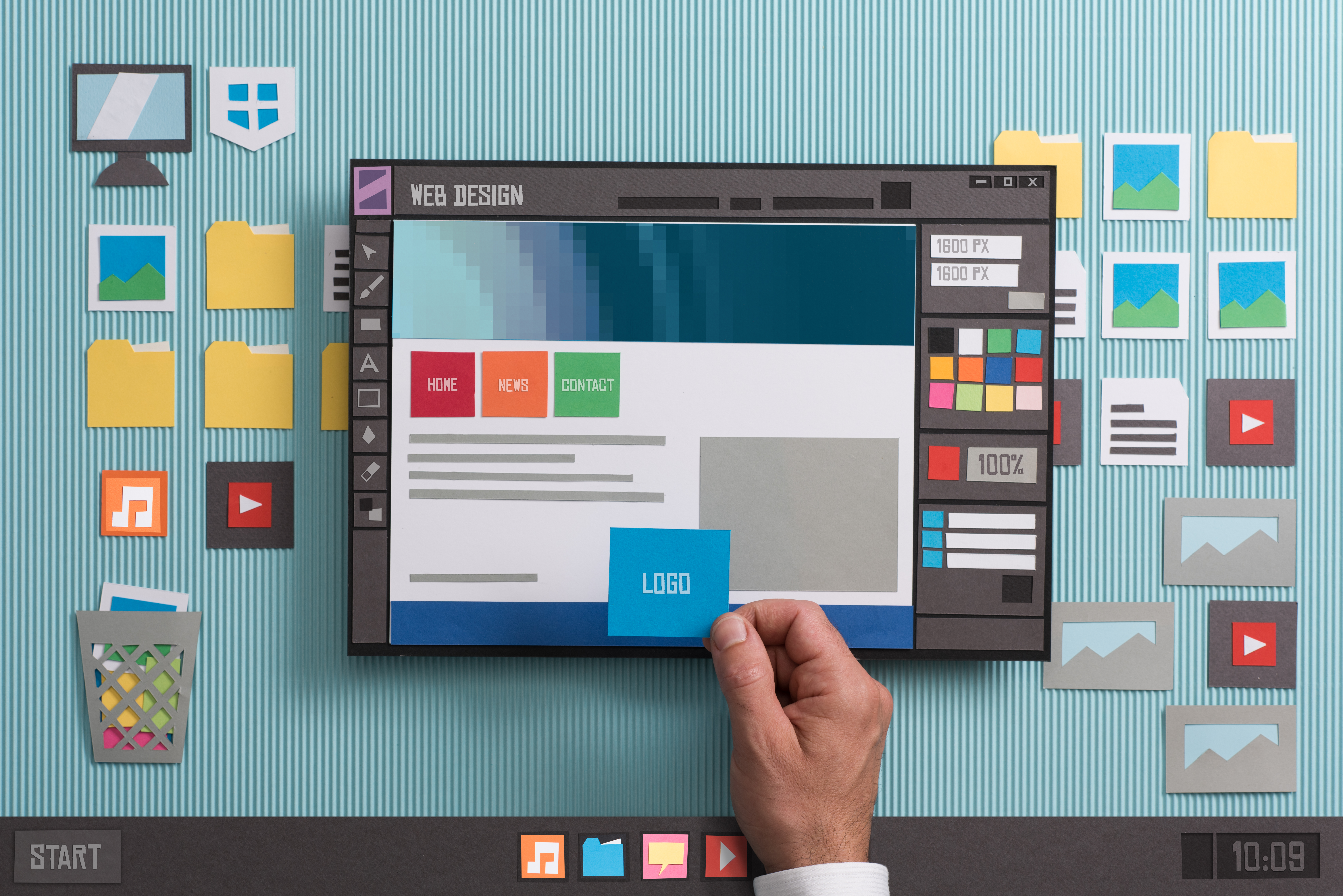 Web designer drafting web templates and web page layouts using a professional software, collage and paper cut composition